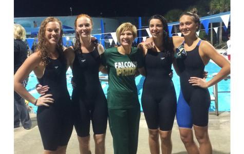 Four senior swim captains lead team to states