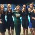 From left, seniors Lauri Schleicher, Kristi Schleicher, Coach Lee, Kristen Brockett, and Ellie Berdusco bask in their time at states.