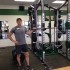 Mr. Shultes stands by his weights, in his new office.