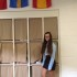 Junior Laura Rodriguez poses in front of the Spanish flag.