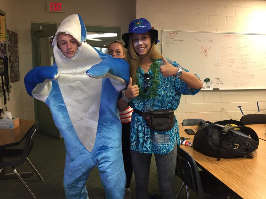 The onsie, seen here in shark form, is an easy, effective last minute choice that can be found at Target or Walmart.  Pictured: Wyatt Sevin and Jackie Schlossberg.
