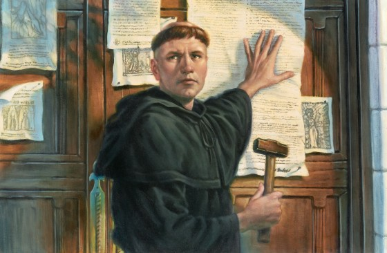 An artist's depiction of Martin Luther nailing his 95 Theses to the church door.