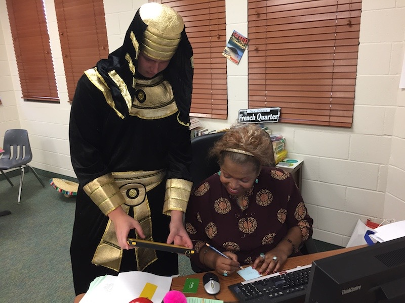 Junior Max Runde gets extra help from Profesora Loaiza, dressed as a pharaoh for Homecoming.