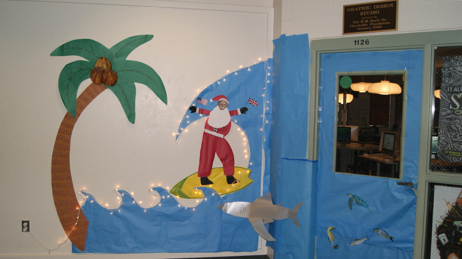 Ms. Grady's door took the regional approach toward this year's advisory door decoration contest with a Santa surf scene.