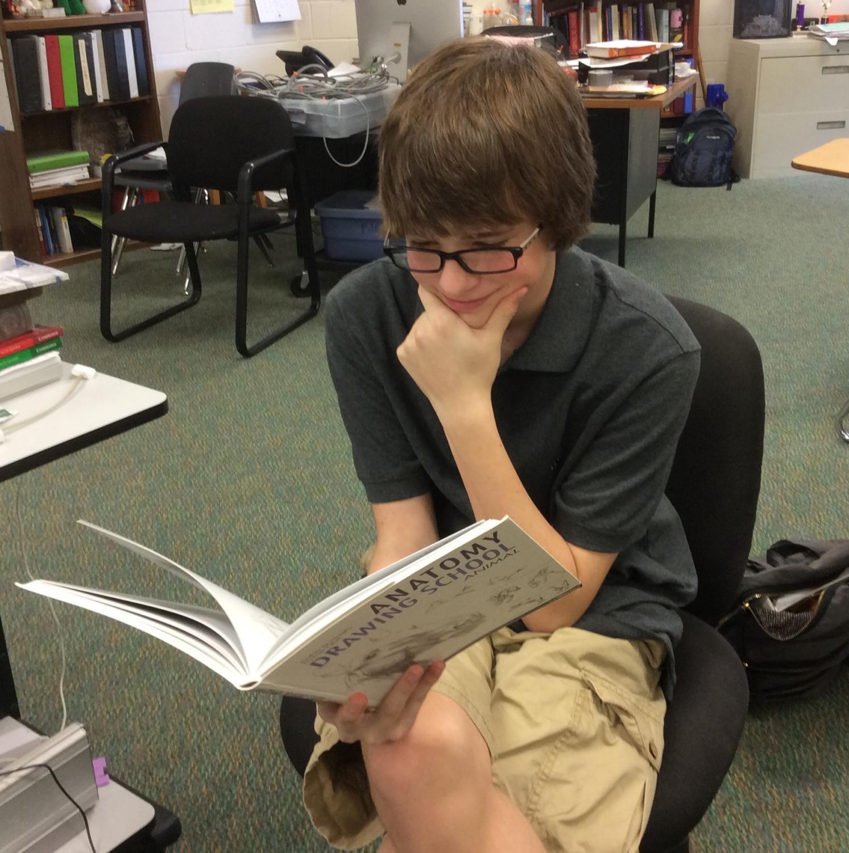 Sophomore Paul Williams enjoys a good book.