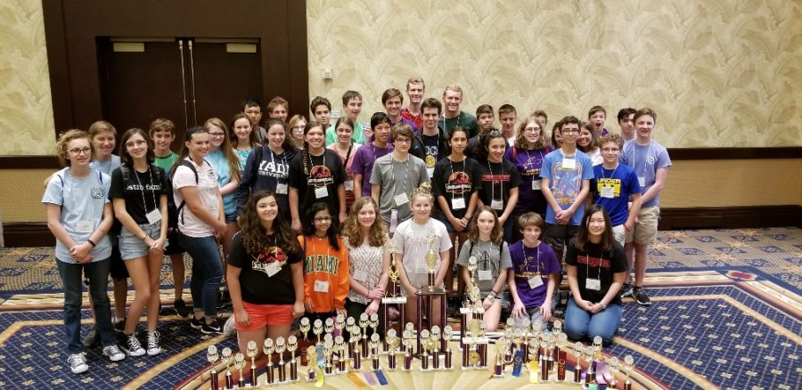 The Latin team poses with all the trophies and ribbons they earned