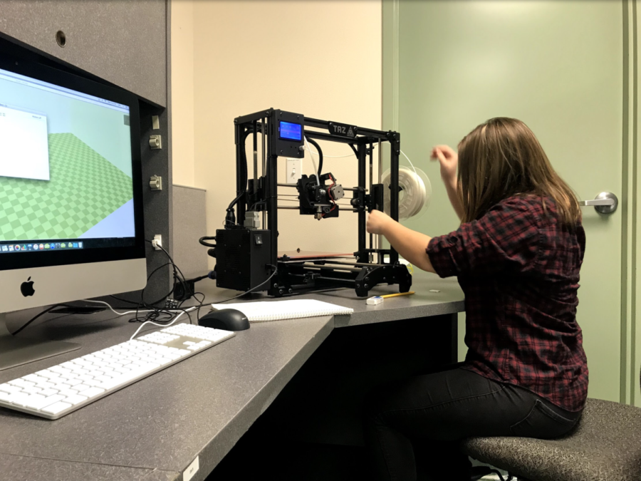 Senior Amy Woodworth working on her independent study in 3D printing