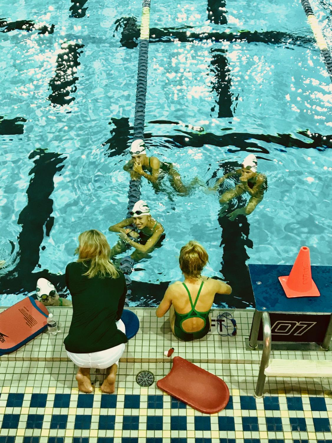 Coach+Sheri+Hart+instructs+a+group+of+swimmers+at+Emory+University%27s+indoor+aquatic+center.