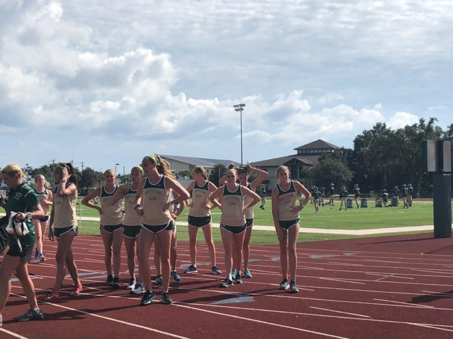 The girls cross country team preps for the meet.