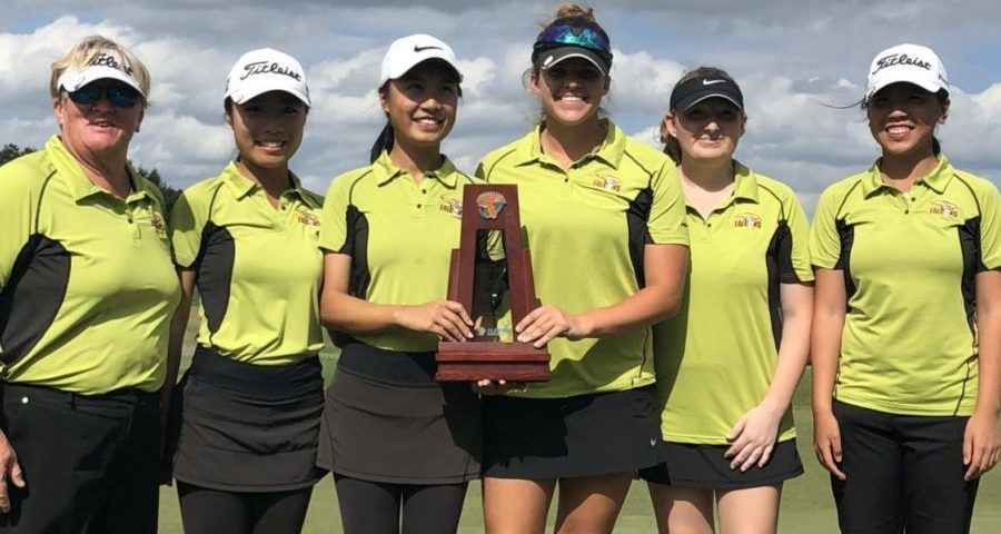 The varsity girls golf team after their regional championship.