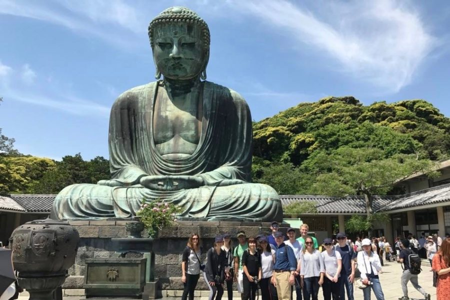 Students visit the Great Buddha of Kamakura at the Kotokuin Temple.