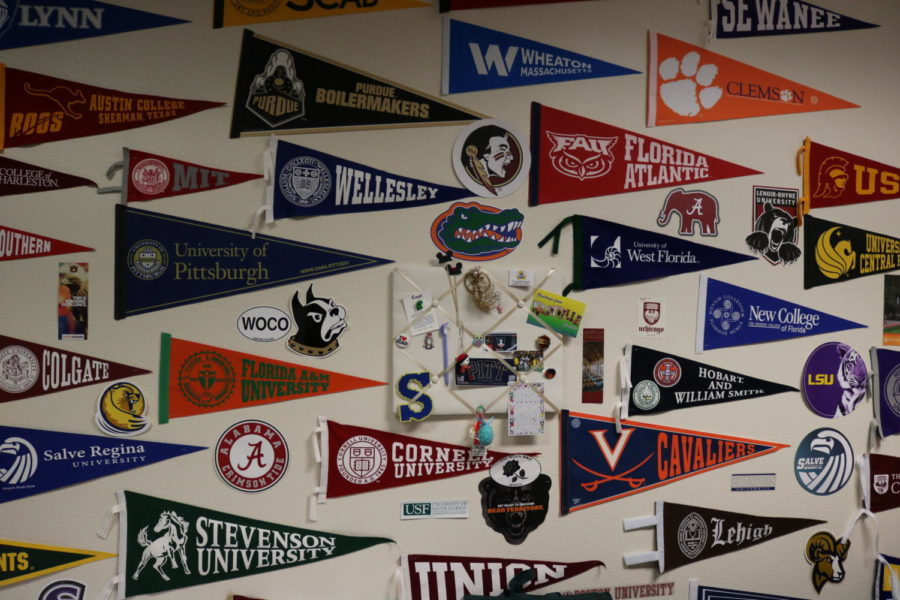 College pennants adorn the walls of the college counseling office.