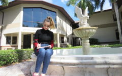 Junior, Meg LaFollette, does pencil sketches by the iconic falcon fountain in the courtyard.
