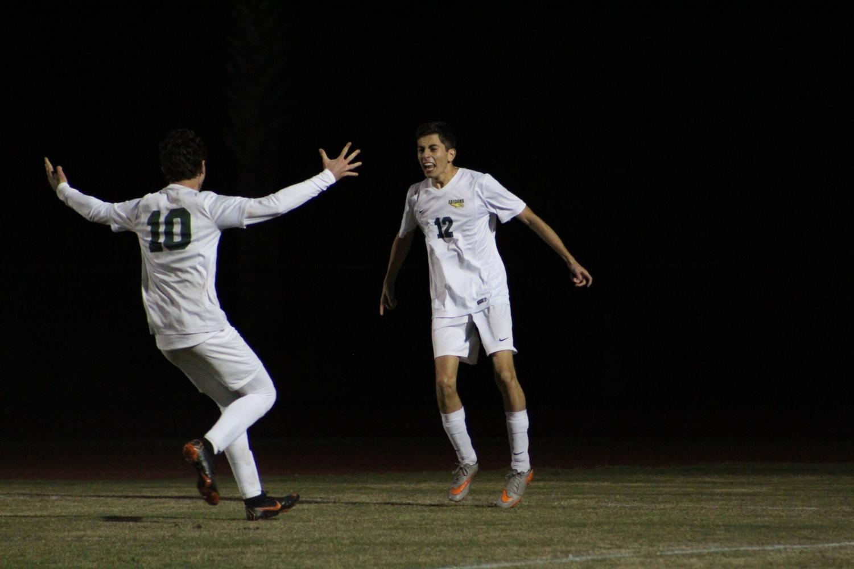 Seniors Noah LaBelle and Andy Sevilla celebrate a goal.