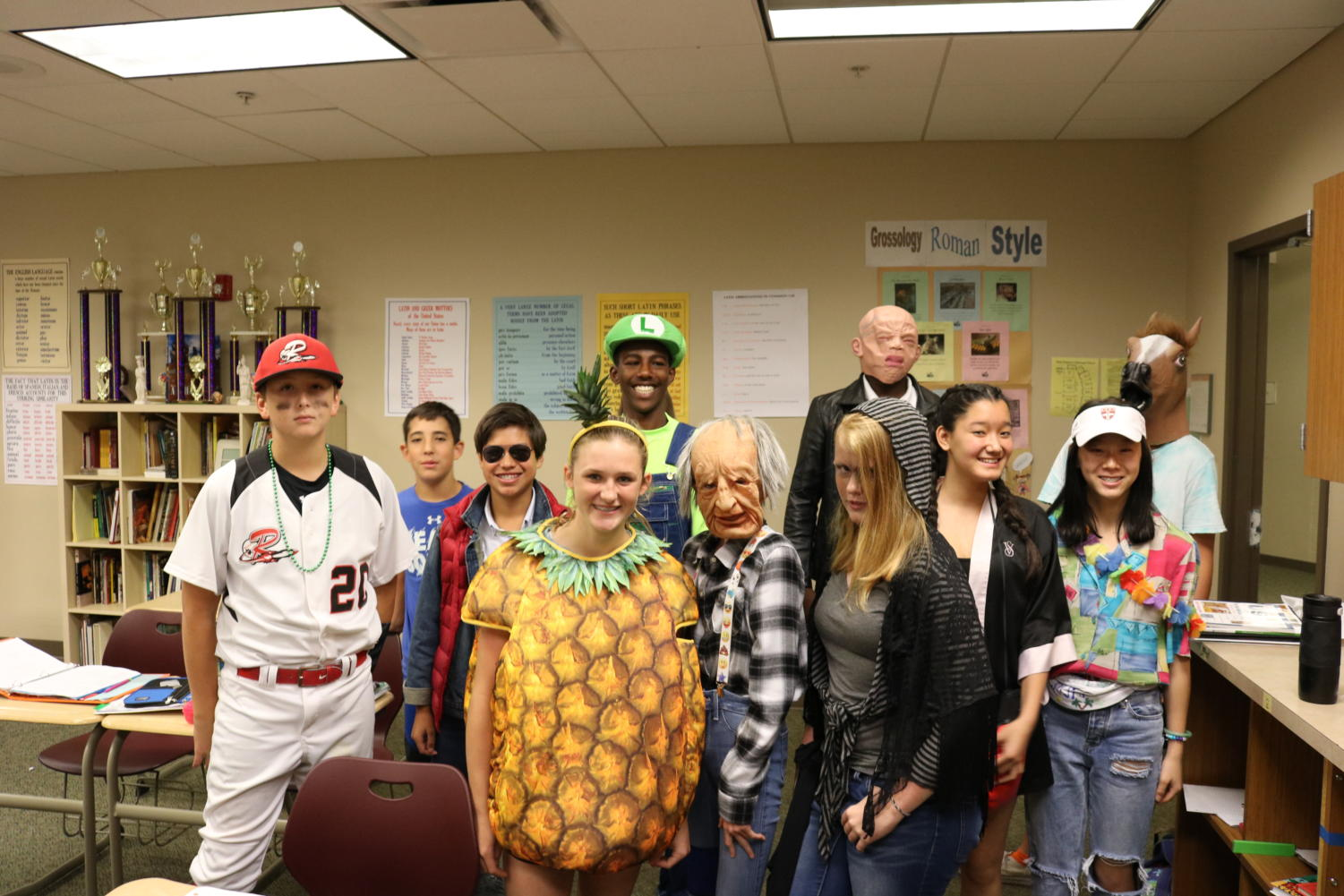 8th+graders+in+Mr.+Haakman%27s+class+pose+in+their+Halloween+garb.
