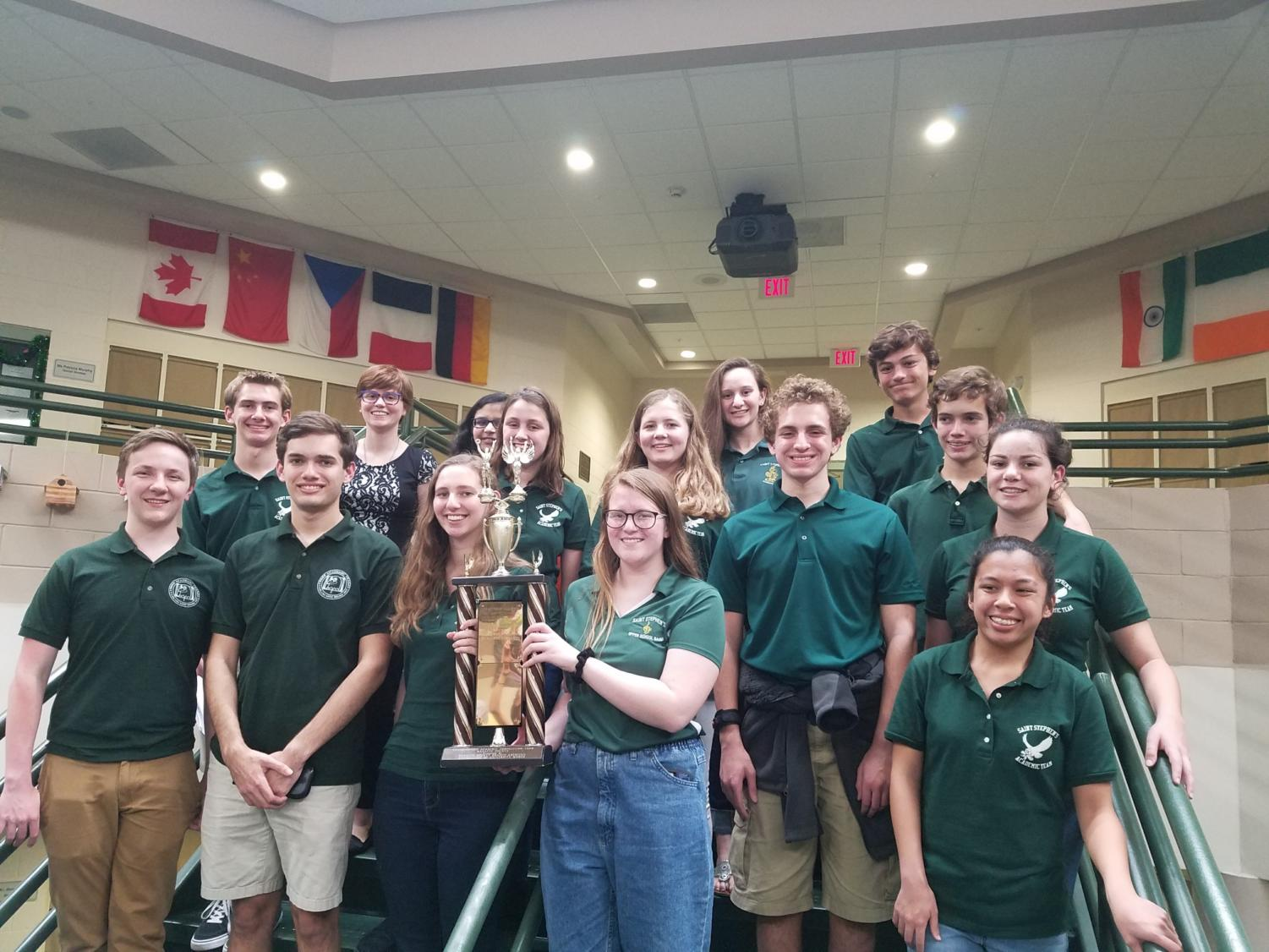 The 2018-19 academic team poses for a group photo, proudly presenting their trophy.