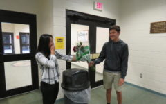 Chaz Oyler gives Allie Serterides a bouquet of carnations for Valentine's Day