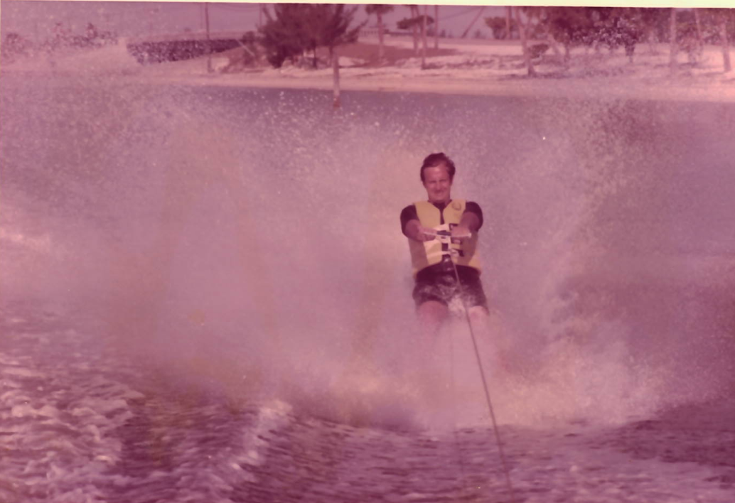 Mr. Holt participating in one of his favorite hobbies, waterskiing.