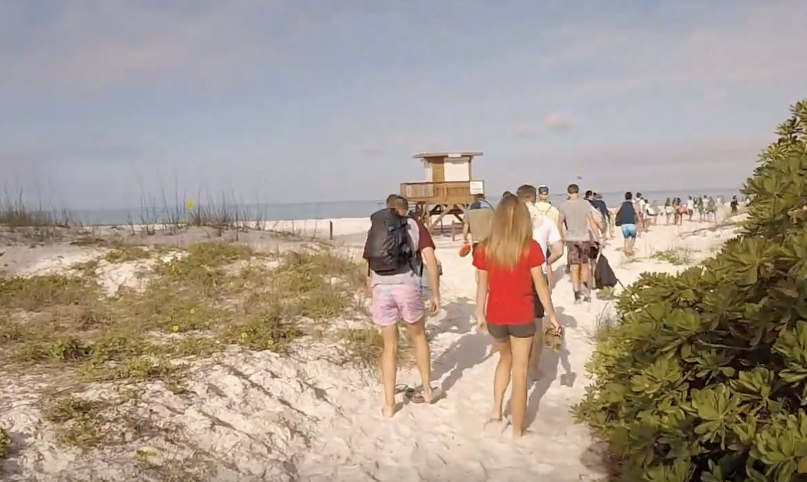 Upper School students walking to Coquina Beach last year's beach day.