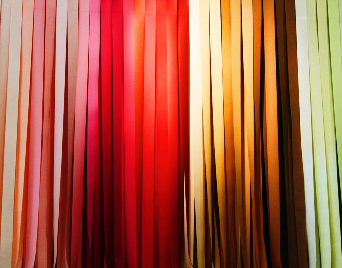 Red%2C+orange%2C+and+yellow+ribbons+are+shown+hanging+from+the+ceiling+in+this+image.
