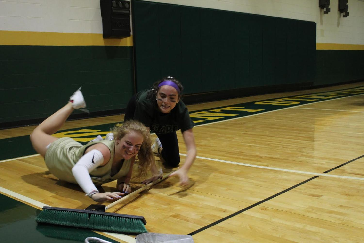 Seniors+Cate+Mulqueen+and+Hannah+McCurry+add+a+humorous+skit+to+the+game.