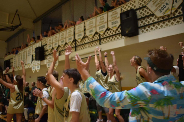 The+team+celebrates+a+made+basket.