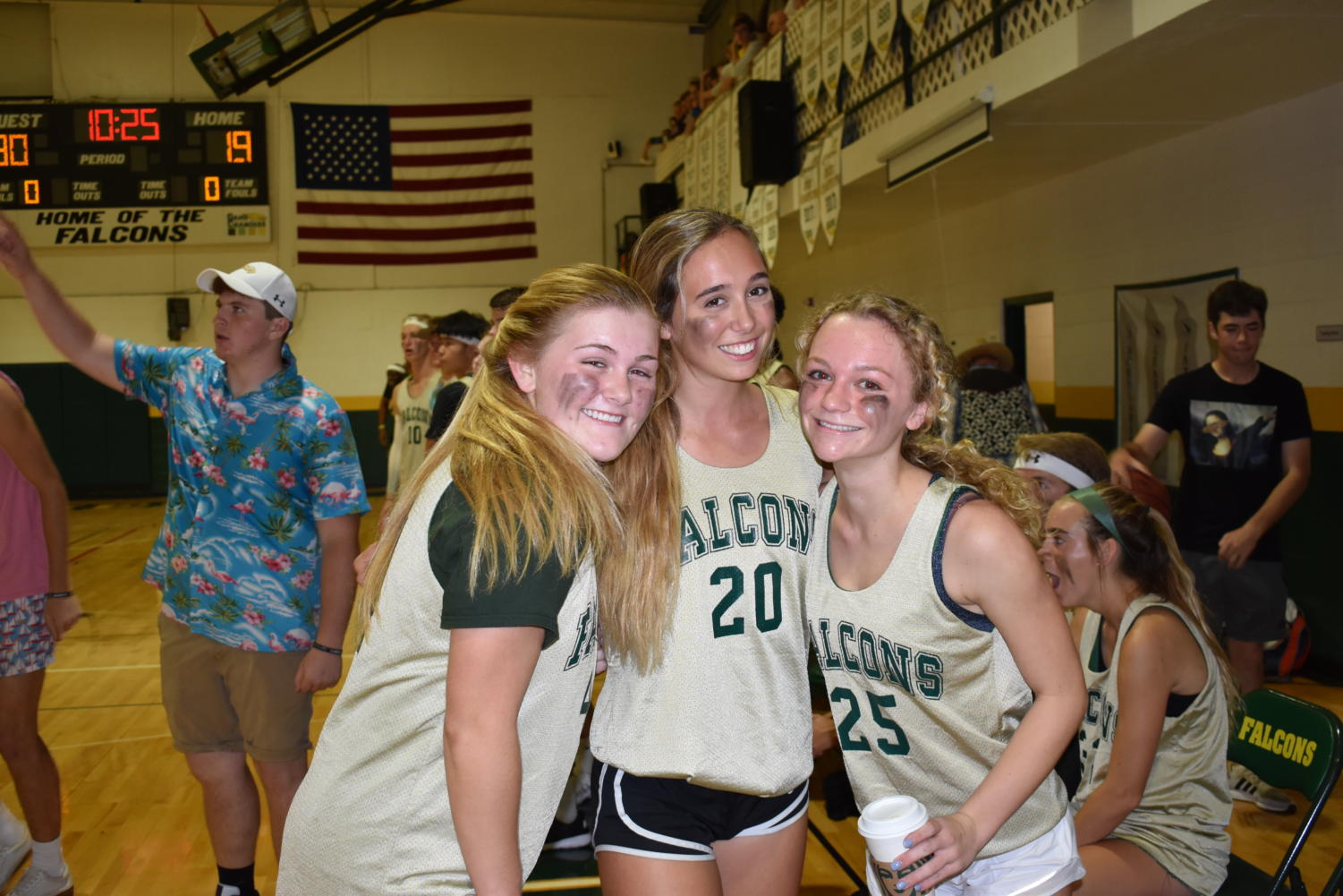 Seniors+Avery+Robinson%2C+Jackie+Schlossberg%2C+and+Kate+Folkens+smile+despite+being+down+against+faculty.