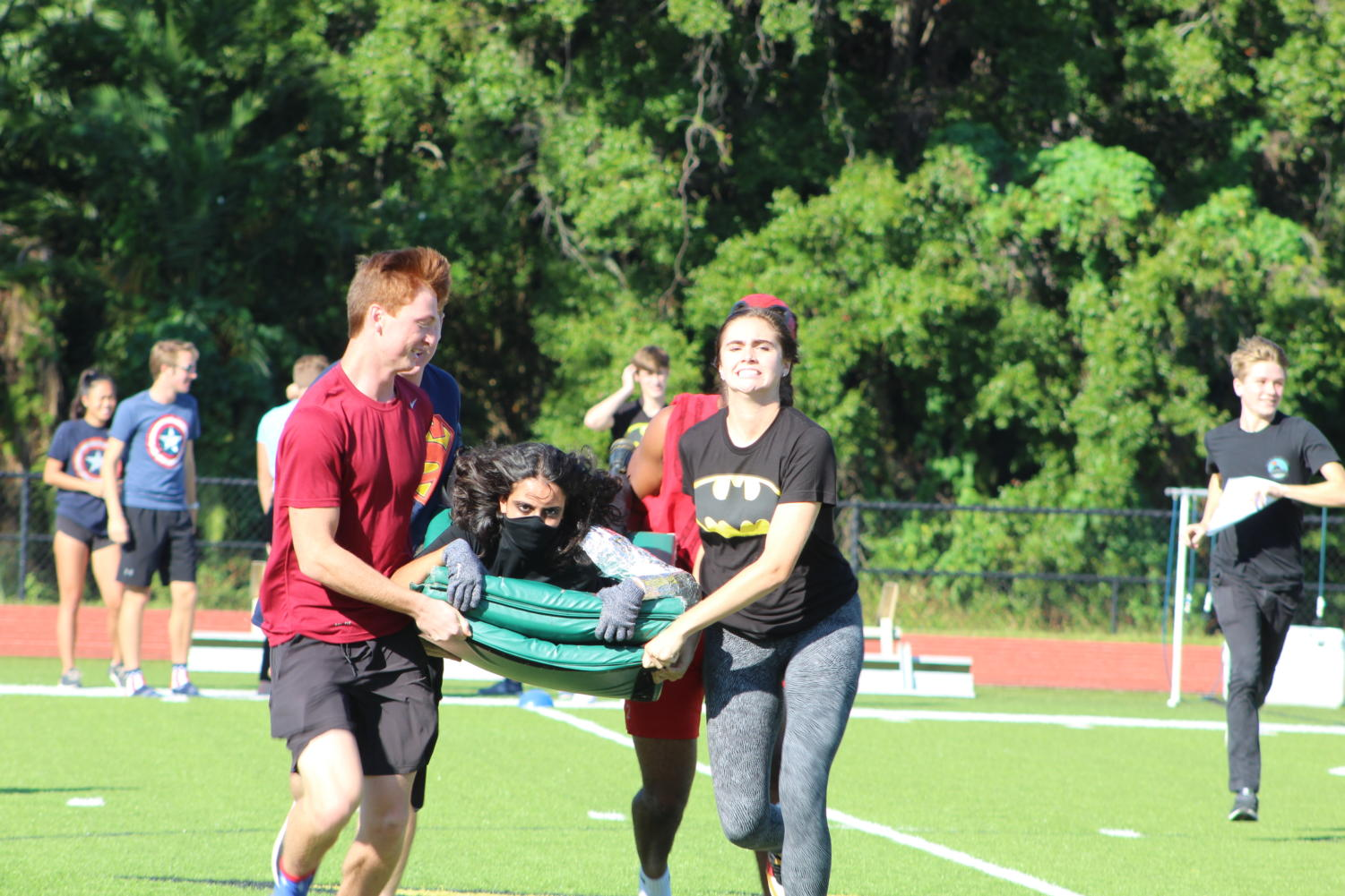 Senior+Gabby+Crenetti+struggles+to+balance+while+being+carried+across+the+feild.