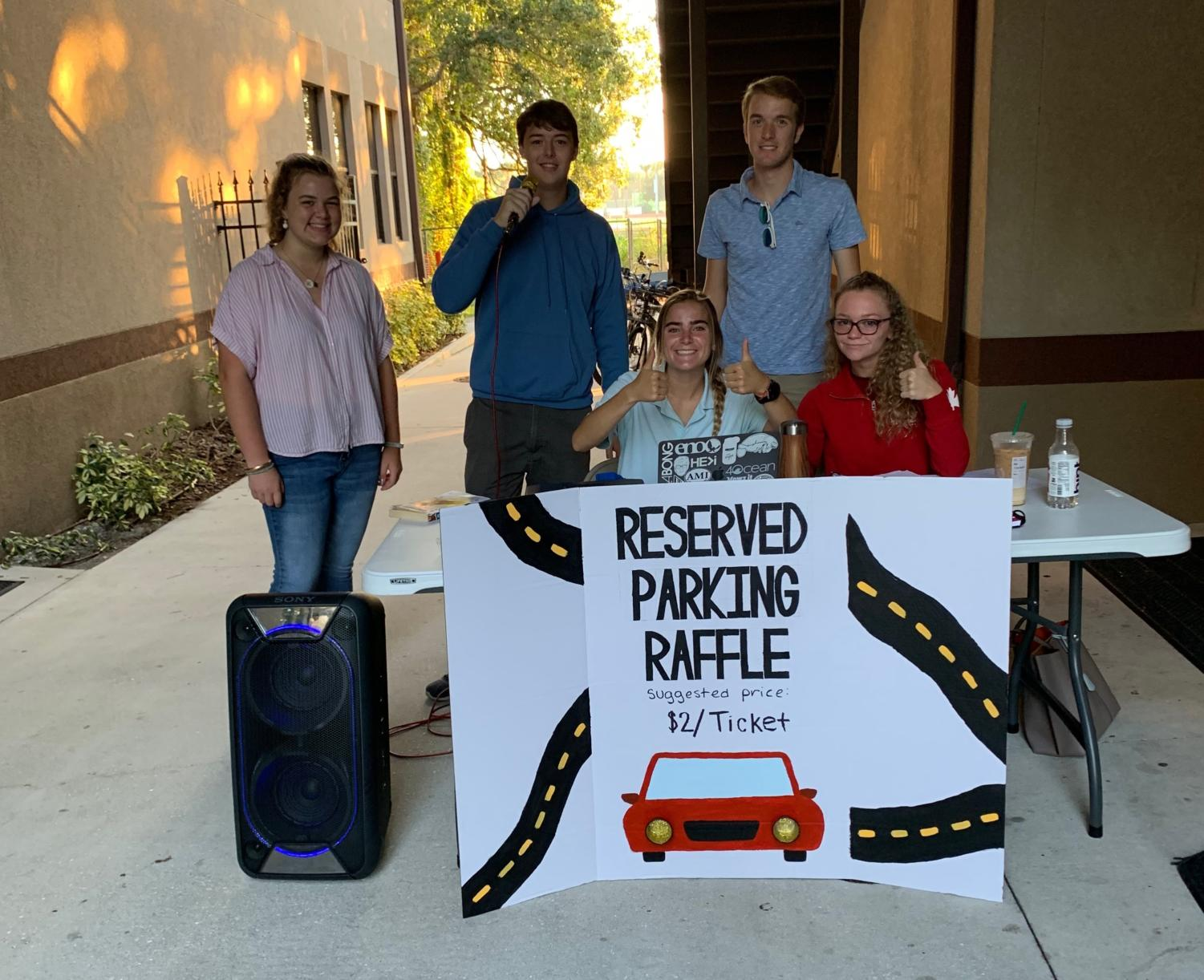 StuCo members outside the Turner Building on Monday, initiating the Reserved Parking Spot fundraiser.