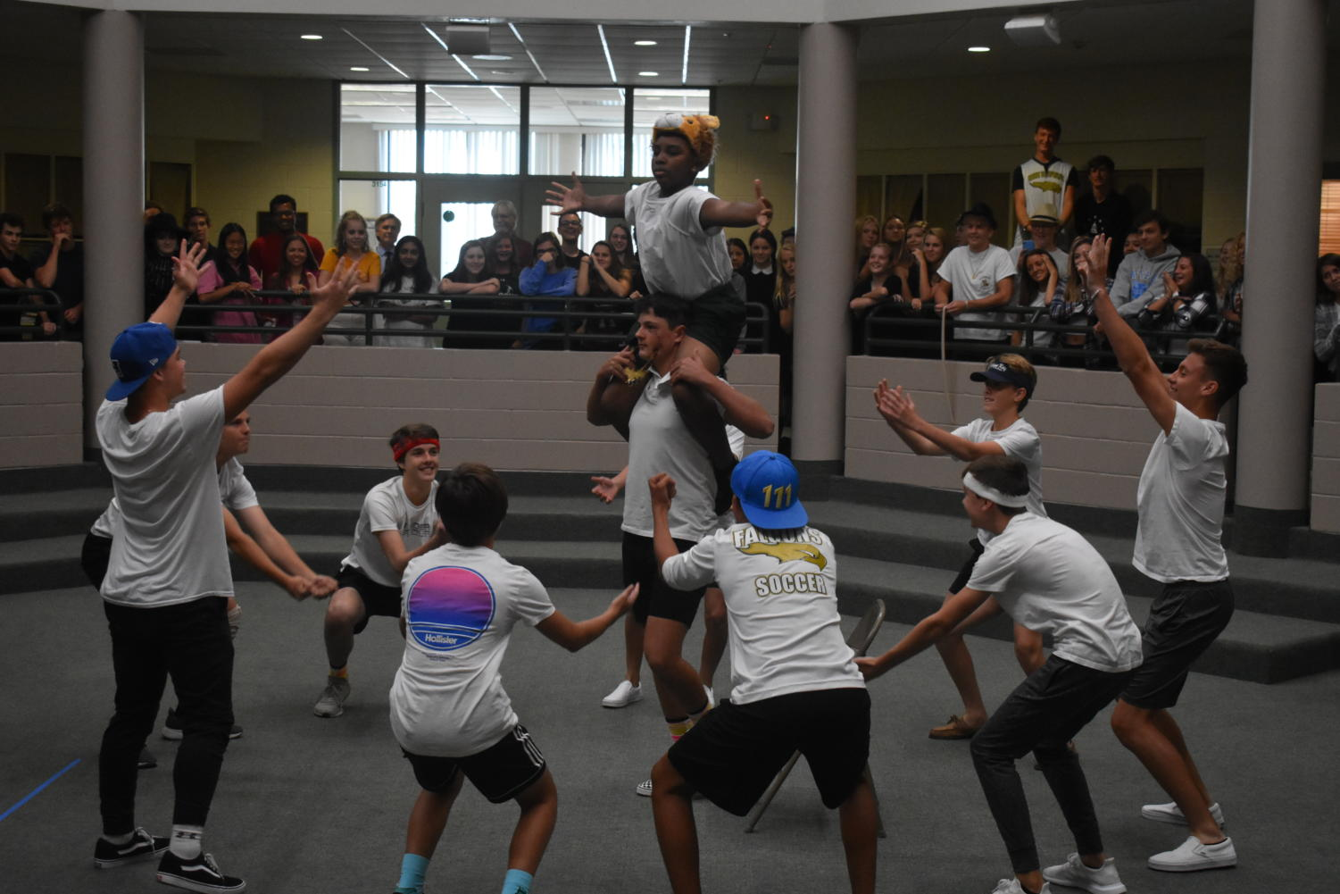 Freshman+Asa+Watkins+is+lifted+up+during+the+performance+of+%22The+Circle+of+Life.%22
