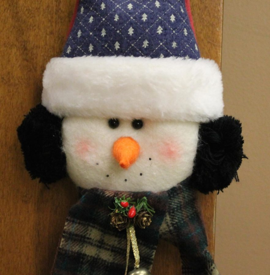 Mrs. Revard is getting into the Christmas spirit by putting up decorations like this one, a snowman door decoration!