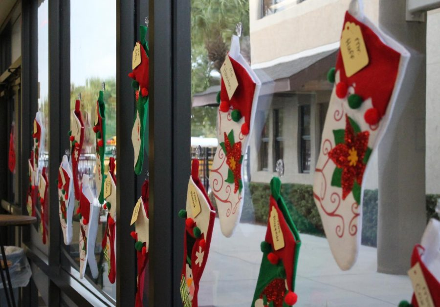 On the front glass of the Middle School, each teacher has their own Christmas stocking!