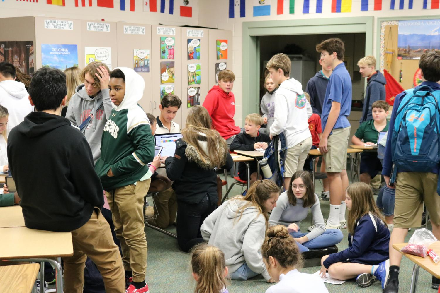 The+Freshman+Class+gathered+in+Mrs.+Verges-Oller%27s+classroom+to+meet+their+Falcon+friends.+