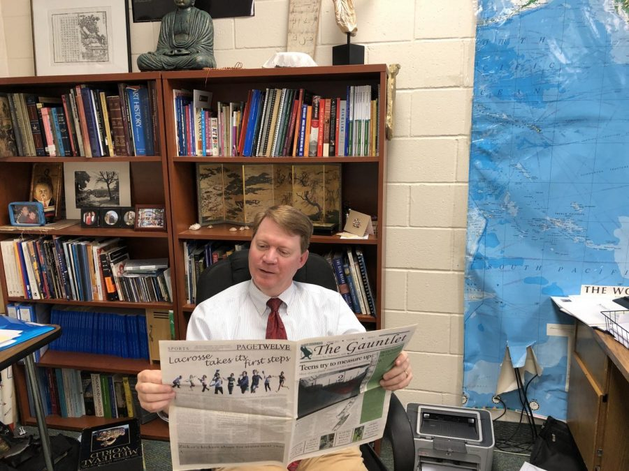 Mr. Whelan, reading an old edition of The Gauntlet, is one of the most committed readers of The Gauntlet.