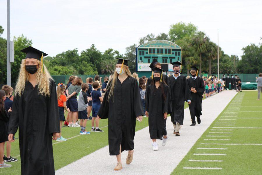 Here, 6 of our beloved Saint Stephens seniors walk the Senior Walk with pride.