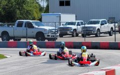 Rosser in action as he commands his go-kart around a track.