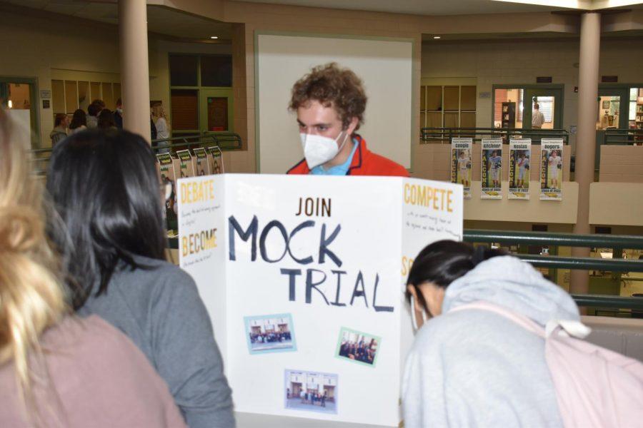 Senior Tyler Kadivar explains Mock Trial to classmate Angel Dai.